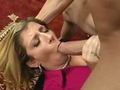 Bra busting Sara Jay fills her mouth with a massive meatpole