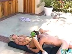 Blonde Britney Skye sunbathing by the pool and gets her shaved pussy licked