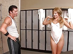 Adorable lovely blonde cheerleader undressing in the locker