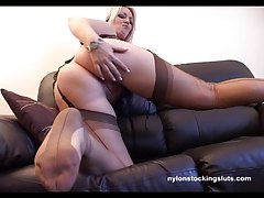 Blond bitch with posh butt teasing in stockings
